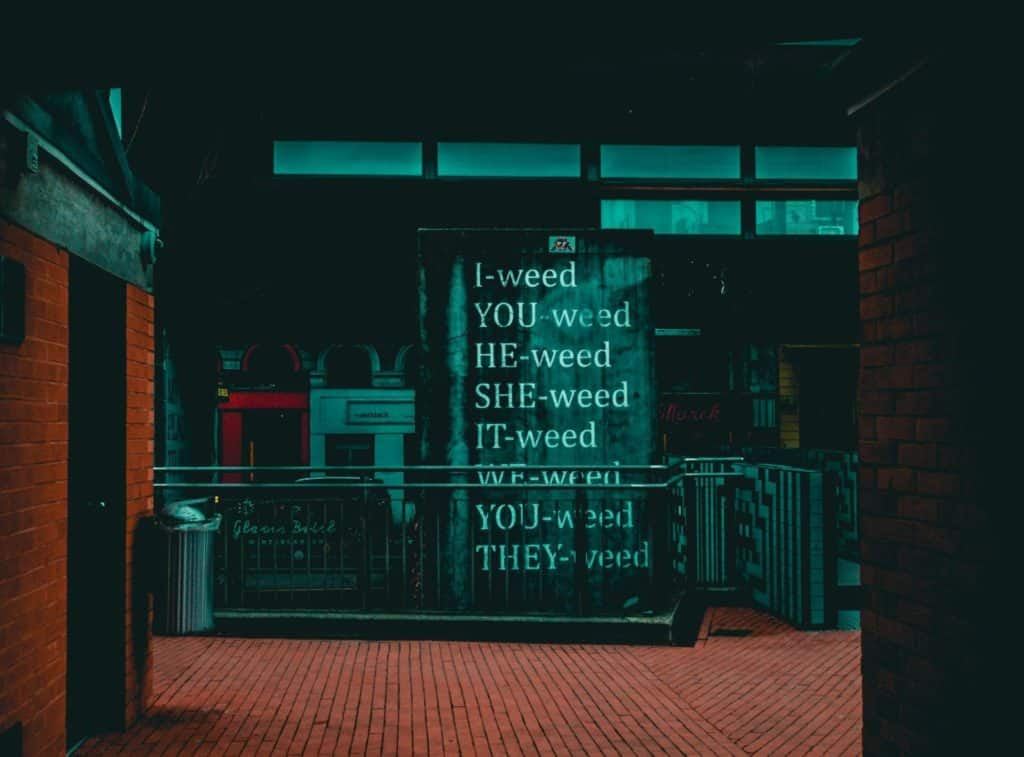 A store front with weed poem on window